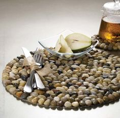 We create each piece by hand using river rocks that are washed and polished before affixing to plastic netting. Do not expose your BeachStone to excessive heat. Our Runner comes rolled in a small cardboard sleeve. Placemats are sold open stock. Of course, rocks are inherently weighty so please expect shipping costs to reflect the same. #organize #style #decor