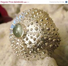 After searching on Etsy for seemingly forever, found this amazing casted sea urchin ring. Someone, who feels nice, it's a mere $211.65.