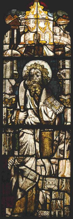 A stained-glass window, attributed to the workshop of Thomas of Oxford, 1404-22, in Winchester Cathedral, Hampshire, depicting St Bartholomew holding his attribute, a flaying knife, plus a holy book. (The Stained Glass Museum)