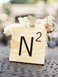 Giant Scrabble tile table numbers.  Event Planning: Conley Perry Of Fleur De Lis Events | Floral Design: Gardenia Floral Design. Photography: Laura Leslie Photography - lauralesliephotography.com