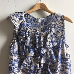 CAbi Silk Top Beautiful blue, charcoal and grey print sleeves less blouse.  100% silk.  In like new condition. CAbi Tops Blouses