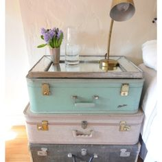 Adorable suitcase night stand. Great for guest bedroom.