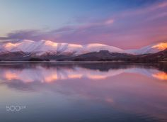Snow-capped hills of Skiddaw (reflected in Buttermere, England) by Verity Milligan on 500px