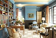 London Calling. Lovely gold and blue color scheme in this Belgravia, London neighborhood library. Elegant  writing desk, handsome books, and neoclassical details lend an aristocratic air.   Photo: Christopher Sturman/Trunk  Interior: Garrow Kedigian Interior Design