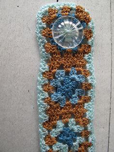 Granny square bracelet with #10 perle cotton and vintage plastic button.