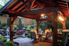 Gorgeous covered patio with outdoor kitchen and lighting. From 1 of 8 projects by Alderwood Landscape, discovered on search.porch.com #outdoorliving