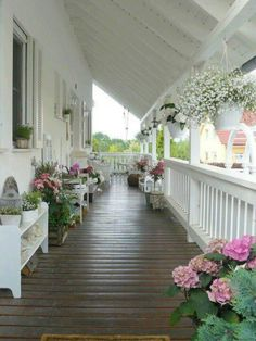 Wrap around porch with all these beautiful flowers - YES PLEASE!!!