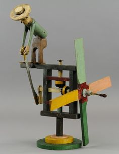 Lot:800: MAN TURNING LEVER WHIRLIGIG, Lot Number:800, Starting Bid:$1000, Auctioneer:Bertoia Auctions, Auction:800: MAN TURNING LEVER WHIRLIGIG, Date:05:00 AM PT - Mar 26th, 2011