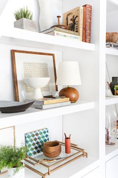 3 Steps to Styling Out Your Shelves 3 Steps to Styling Your Bookcase_Emily Henderson_midcentury_bookshelf_modern_blue_white_books_detail 1 Styling Bookshelves, White Bookshelves, Built In Shelves, White Shelves, Bookcases, Built Ins, Open Shelves, Bookshelf Ideas, Bookshelf Decorating