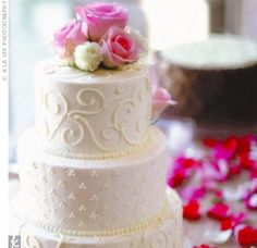 The bride's cake was a champagne and Cointreau-flavored angel food wedding cake with raspberry filling and vanilla cream icing topped off with pink and ivory roses. For the groom's cake, Aimee and Chris chose a midnight chocolate torte with choc...