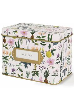 """This beautiful recipe box is a wonderful addition to your kitchen. It features a pretty floral design called """"Herb Garden"""". The gold label frame on the front holds a card that says """"RECIPES"""" and it includes 12 tri-tab dividers and 24 blank recipe cards. The included cards are the Charcoal Spoon style, and you can purchase more of these to accommodate your favorite recipes.    Dimensions:4.75"""" tall by 4.25"""" wide by 6.5"""" long.   Herb Recipe Box by Rifle Paper Company. Home & Gifts - Gifts…"""