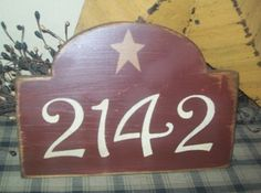 PRIMITIVE ADDRESS PLATE! (But I would rather have ours rectangular, and black so it wouldn't clash with the white and green on our house)