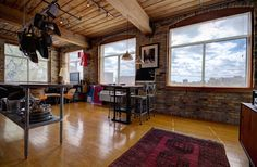 Keeping Hard Wood Flooring Looking Its Best Toronto Lofts, Industrial Office Space, Hardwood Floors, Flooring, Exposed Brick Walls, Open Concept Kitchen, Wood Ceilings, Valance Curtains, The Unit