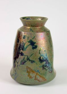 A Iridescent and Lustre Earthenware Vase  Designed by Lucien Lévy-Dhurmer, Executed by Clément Massier, circa 1887  With pinched sides, decorated with butterflies amidst lilies, painted signature Clement Massier, Golfe Juan AM, stamped CLEMENT MASSIER GOLFE JUAN (AM) L LÉVY