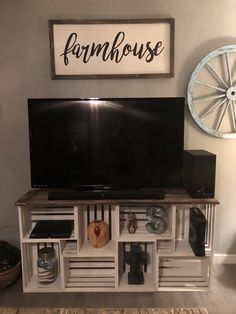 Tv stand made out of wood from our old barn and wooden crates.