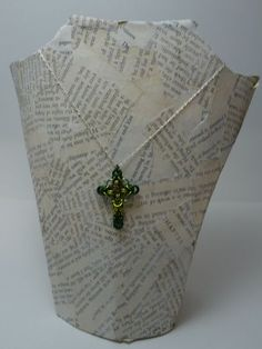 necklace display from a cereal box and book pages tutorial