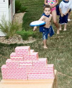 Super Hero Game. Knock down the wall with Captain America's shield (AKA frisbee with logo). Kids loved it!