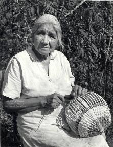 Cherokee woman weaving a ribbed white oak basket