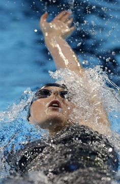 Missy Franklin swims to victory in the women's 200-meter backstroke final at the U.S. Olympic swimming trials on Sunday, July 1, 2012, in Omaha, Neb. (AP Photo/Mark Humphrey)