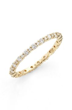 Timelessly elegant and perfect for everyday wear, this slender stacking ring is made from polished 18-karat gold and traced with forty radiant diamonds.