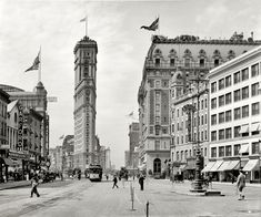 """New York circa 1908 - """"Times Square."""" The old New York Times building, now encased in billboards, Hotel Astor and various theaters seen from Broadway."""