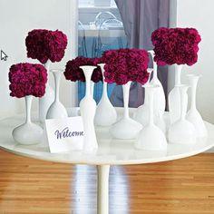 Unique centerpieces, white vases with colorful floral