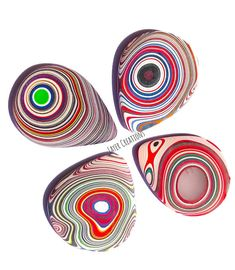 Guitar picks made form fordite can make any size you want. These are very unique never be one like it. Very sturdy never wears down has a different kind of tone when using it. ** These are special order message before you buy.