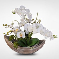 Creamy white orchids gather low and full in this wonderful metal pot for a stunning effect. This lovely silk flower arrangement would be a terrific addition to Orchid Flower Arrangements, Contemporary Flower Arrangements, Orchid Centerpieces, Elegant Centerpieces, Beautiful Flower Arrangements, Beautiful Flowers, Silk Orchids, White Orchids, Silk Flowers