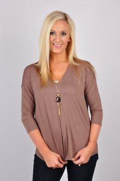 While wearing this top, everyone will be Sheering You On! This top has ¾ sleeves and a V-neck slit drape cut. This high-low top is made out of 60% Polyester, 35% Rayon, and 5% Spandex. The contrast is 100% Polyester. Machine-wash cold. Hang dry.