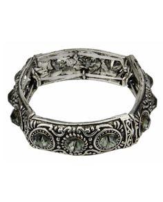 Pulseira elástica de metal prata velha com strass fumê