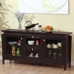 @Overstock - With crisp lines and a striking design, this Benston cabinet features a solid, finely crafted look. This coffee bean finished furniture boasts multiple cabinets with glass doors for ample storage.http://www.overstock.com/Home-Garden/Benston-Coffee-Bean-Buffet-Cabinet/6087992/product.html?CID=214117 $288.99