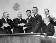 March 31, 1965.Gemini 3 astronauts John Young and Gus Grissom are greeted in Chicago by Hugh Dryden of NASA, Mayor Daley of Chicago, and Illinois Governor Otto Kerner.