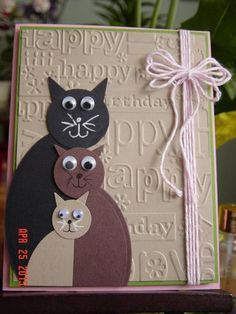 handcrafted card: A Zindorf Case by Redbugdriver ... punch art cats on an embossing folder texture of birthday word ... cute multi-loop string bow ...