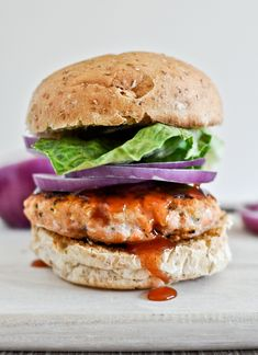 bbq salmon burgers | • makes 4 burgers • 1 pound fresh, raw salmon (skinless or skin removed) • 1/3 cup panko breadcrumbs • 2 tablespoons bbq sauce • 1 tablespoon dijon mustard • 2 tablespoons freshly grated parmesan cheese • 2 garlic cloves, minced • 1/2 teaspoon black pepper • 1/4 teaspoon salt • 1/2 teaspoon onion powder • 1/2 teaspoon smoked paprika • 4 whole wheat buns