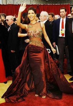 Elie Saab designed this sheer-bodiced, burgundy gown with floral appliqué worn by Halle Berry in 2002 when she accepted her lead actress Oscar.
