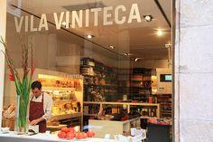 Vila Viniteca... es una de las distribuidoras de vinos finos más importantes de Europa. La Teca es su tienda gastronómica de productos gourmet (quesos, jamones, embutidos...), cuyo local conserva el encanto del antiguo colmado familiar. Allí también se organizan cursos de cata y de introducción al mundo del dulce líquido de uvas, y lo mejor es que la tienda tiene una zona de degustación para probar los exquisitos productos maridados con excelentes cavas y vinos. ¡Un lujo!
