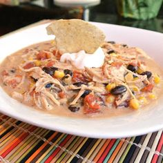Crock Pot Chicken Tortilla Chili  *made* Loved it, never throw away the crumbs of the tortilla chip bag again, just make this and throw them on top! So yum!