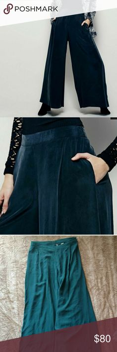 Free People Wide Leg Silk Pant New without tags Free People moonlight silk pants. Has a zipper and clasp closure as well as pocket. So easy to pair. Perfect for spring. Marked a size 10 may also work for a 8 or 12 depending on desired fit.  ✨all offers accepted or countered✨ please be reasonable with your offers- consider posh takes 20%✨thank you!✨ Free People Pants