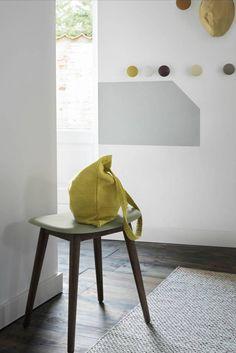 A solid-oak wood base brings a naturalistic bent to this Fiber Stool by Danish modernist brand Muuto. #AplusR #moderndesign #interiordesign #modernstool #muuto #livingroomideas #entryway #woodenstool #seatingideas