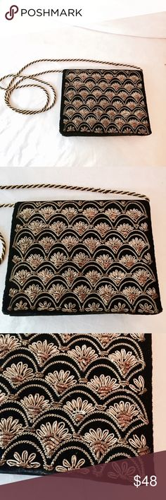 ✨HP✨ Vintage black velvet gold embroidered handbag Absolute stunning! Vintage 1960s black velvet handbag. Box bag fit. Can be worn as a croaabody or one shoulder as an evening bag. gold embroidery and beading on the front of the purse. Black and gold braided strap. Snap closure and slots for a few cards inside. Excellent vintage condition. There's a teeny tiny bit of wear on one edge. Otherwise this is pristine! So rare to find velvet handbags in this condition! Vintage Bags Crossbody Bags