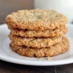 Thin and Crispy Oatmeal Cookies 1 cup all-purpose flour 3/4 teaspoon baking powder 1/2 teaspoon baking soda 1/2 teaspoon salt 14 tablespoons butter (1 3/4 sticks), softened but still slightly cool 1 cup granulated sugar 1/4 cup packed light brown sugar 1 large egg 1 teaspoon vanilla extract 2 1/2 cups old-fashioned rolled oats