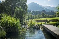 Ein Schwimmteich mit Steg ziert das Landhaus Blaufeld im Kitzbühel. Villa, River, Outdoor, Patio, Green Life, Penthouse Apartment, Real Estate Agents, Water Pond, Swimming
