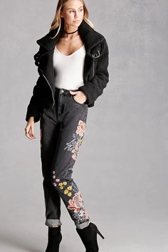 A pair of boyfriend jeans by Pixie & Diamond™ featuring floral embroidery on front, distressed trim, high-rise fit, cuffed ankles, a five-pocket construction, and a zip fly.