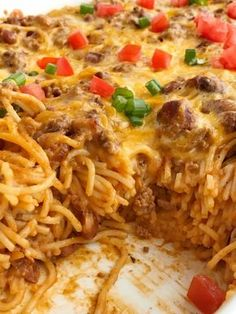 Cheesy taco spaghetti casserole is the ultimate dinner comfort food. Cheesy pasta loaded with taco seasoned ground beef, chili beans, and tomato. Bakes in one pan, serves a crowd, and the leftovers are fabulous for another meal! Together as Family Casserole Spaghetti, Taco Spaghetti, Baked Spaghetti, Spaghetti Recipes, Cheesy Spaghetti, Pasta Recipes, Mexican Spaghetti, Chicken Recipes, Homemade Spaghetti