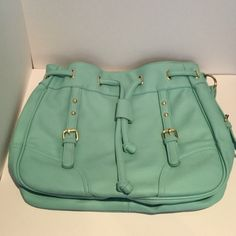 NWOT Light teal purse This light teal purse is new without tags. Shows no signs of wear or damage. There is however a light pink mark that was there from purchase.  Reasonable offers accepted. No trades. Thank you for looking at my closet! Fashion Bug Bags Shoulder Bags