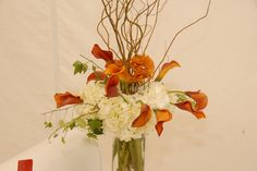 tall centerpiece with hydrangea, curly willow and mango callas