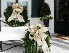 Wreaths embellished with gold ribbon