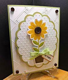 pretty handmade card ... die cutting ... embossing folders ... flower stamped and die cut ...
