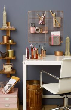 Organize your desk in sophisticated, modern style with a copper-plated basket that stores odds and ends within easy reach.