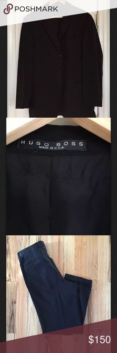 """NWOT Hugo boss men's suit Sz 42R Jacket has three-button closure; notched lapel with felt underlining; four-button cuffs; besom pockets; interior pockets; no vent; relaxed fit. Trousers have French fly with hook-and-bar and button-tab closure; front slant pockets; back besom pockets Approx. length from shoulder: regular 33""""; short 32"""". Jacket is lined, trousers are lined to the knees. Virgin wool; dry clean. By Hugo Boss; made in the USA or imported. Men's Clothing. Modern fit; a closer fit…"""
